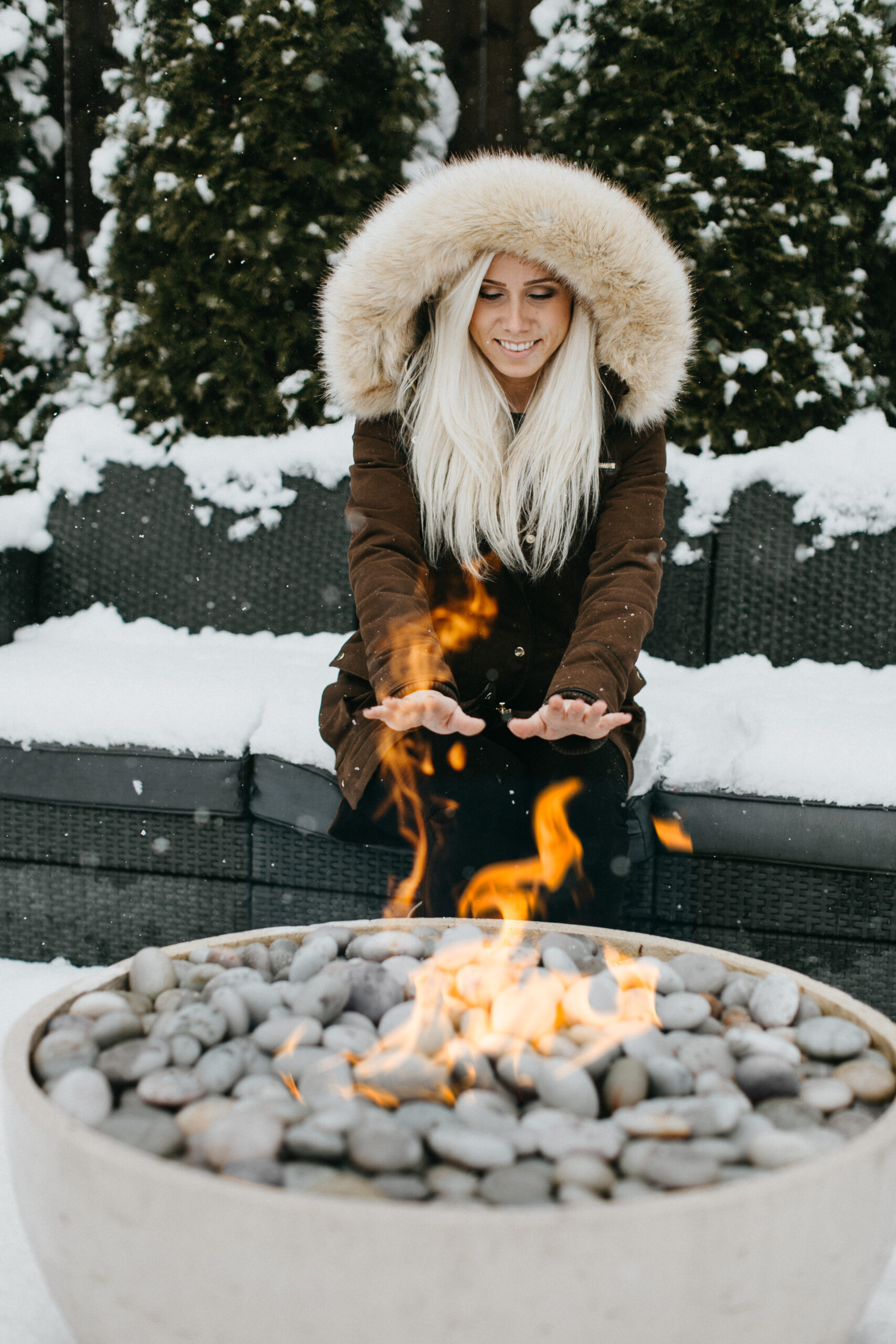 Enjoying fire table in the winter